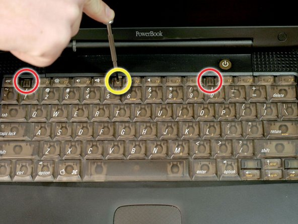 Turn the keyboard locking screw so that it is parallel to the space bar.