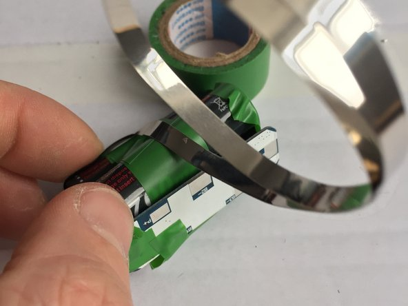 Now you see why the electrical tape is needed for isolation. If the connector roll is touching the wrong parts you may get a short cut, that may brick your PCB.