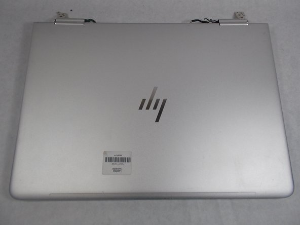 Flip the laptop over so the model sticker faces the ceiling.