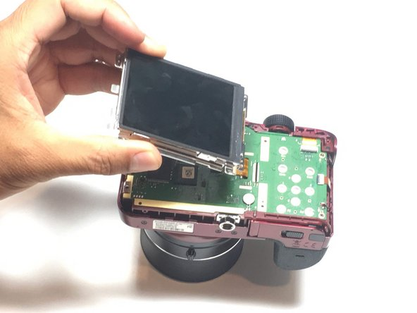 Flip the LCD screen over to reveal the display cable.