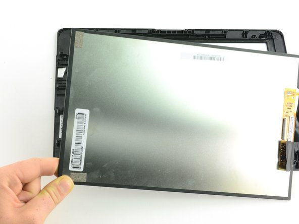 Grasp the edge of the digitizer and lift straight up to remove.