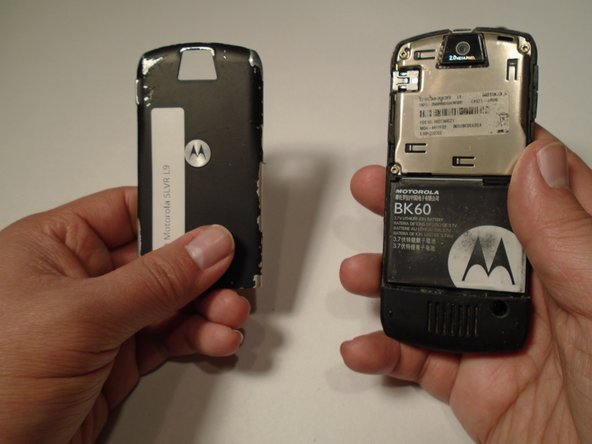 Pull the battery cover down and away from the latch; then lift it up to remove the battery cover.