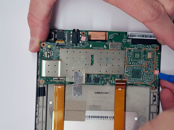 Use a plastic opening tool to gently pry the motherboard out of the frame from each side.