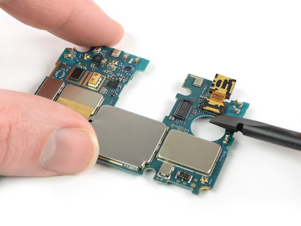 Use the flat end of a spudger to pry up the front-facing camera connector from the motherboard.