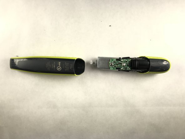 Hold razor in both hands, and place thumbs near crease.
