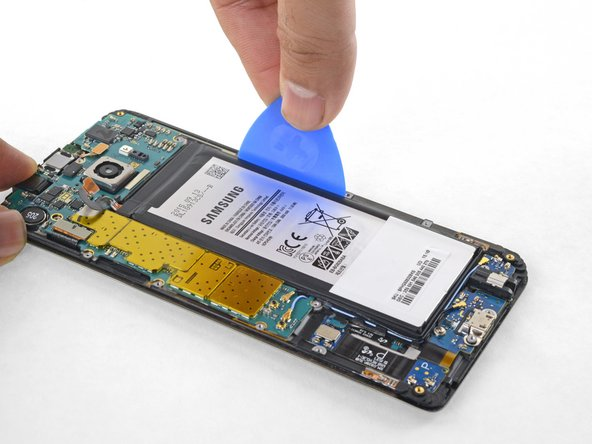 Insert an opening pick between the display frame and the battery.