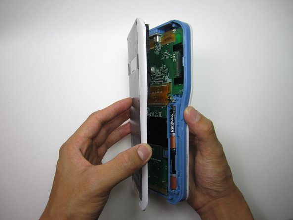 Use your hands to manually separate the now loosened back plate from the calculator.