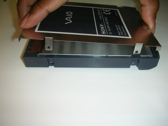 Once you have removed the screws, you can remove the floppy drive core from its casing as shown.