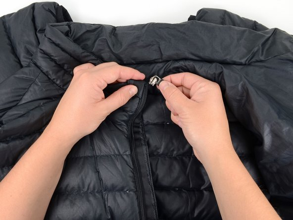 Slide the replacement slider onto the zipper.