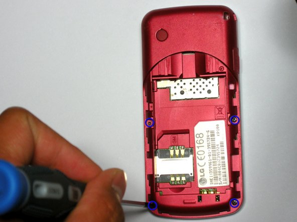 Remove the four screws along the edge of the phone body, as shown in the picture to the left.