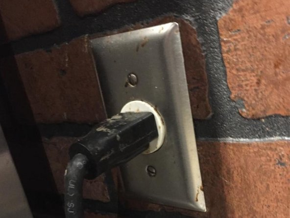 Power off the machine by taking the plug out.