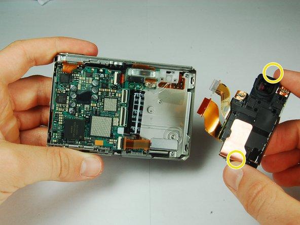 Grasp the CCD Sensor Module and remove it.