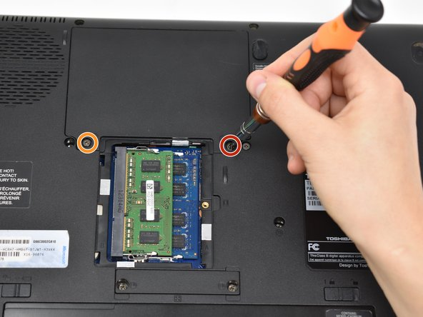Remove the 11mm screw from the right side of the hard drive access panel using a Phillips #0 screwdriver.