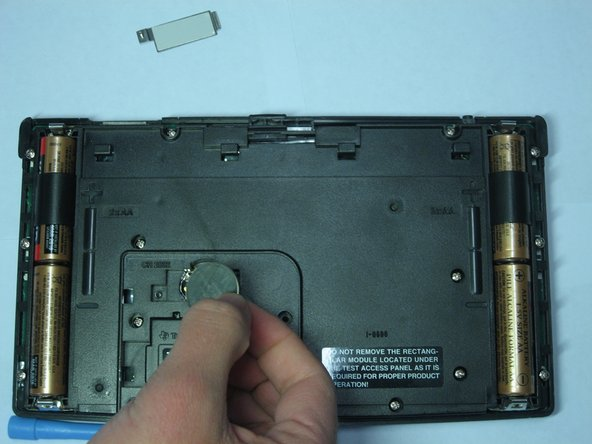 After the battery has been tilted out of its socket, simply remove it with your hands.