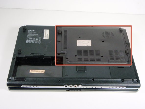 Turn over Acer Aspire 5100 laptop so back of laptop is facing up. There are several removable covers, you want to remove the largest cover.