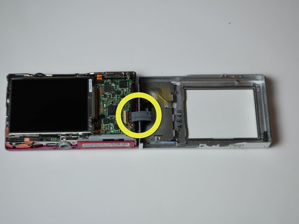 There will be a ribbon cable attaching the front panel to the motherboard, be sure not to tear this.