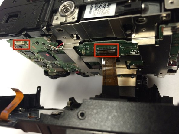 Image 1/2: There are two ribbon cables when opening the camera. Make sure to properly detach them before proceeding.