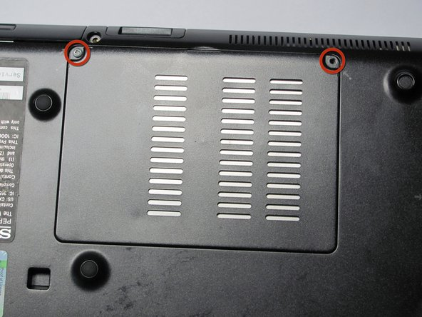 With the laptop still flipped over with the Vaio logo facedown, locate the screws for the RAM