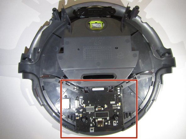 To access the motherboard entirely, lift the top portion of the vacuum off.