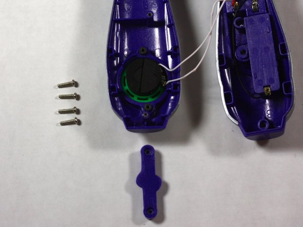 Remove the 2, #8 11.7 mm speaker guard screws with the Phillips Head screw driver.