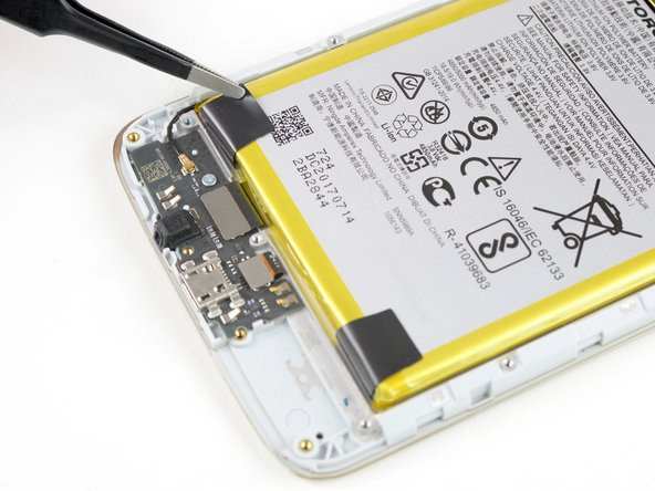 If your battery has two black tabs near the bottom corners, the battery is held in place by stretch-release adhesives. If that's the case,  follow this guide instead to complete your battery replacement.