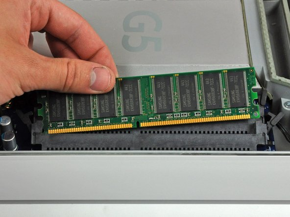 Image 3/3: Be sure the RAM arms are fully rotated away from the RAM socket before reinstalling any RAM chips.