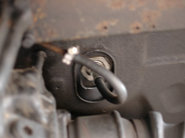 Check the outlet hose from the gas tank at the rear of the car for leaks.