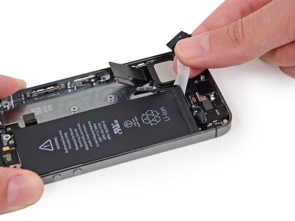 Guide the strip carefully around the corner and up the side of the battery.