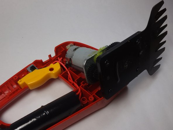 Lift motor and blade away from opposite cover being careful not to remove entire mechanism from the face plate. The idea is to simply expose the screws on the bottom of the blades.