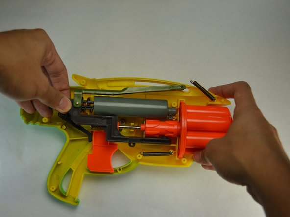 Grab the whole air system and carefully take it out of the main body of the blaster.