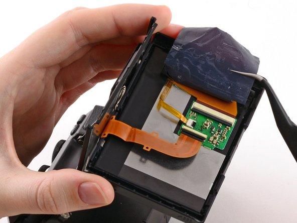 Use tweezers to peel back the plastic cover.