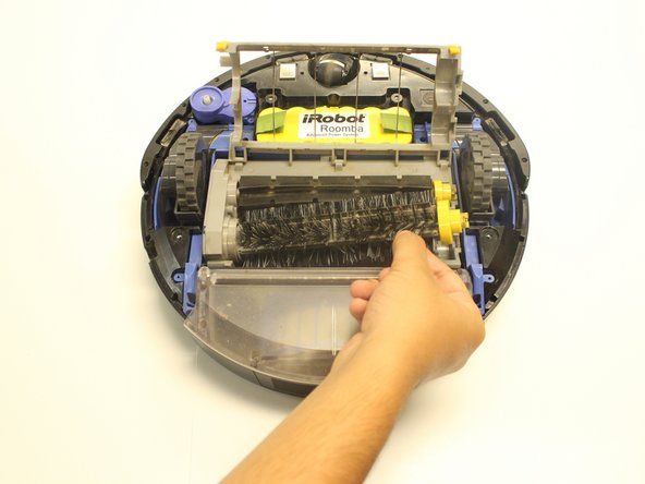Lift the brush from the right side and slide it from its container within the Roomba.