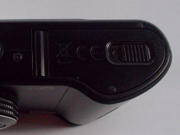 Using your finger, slide the plastic lock-tab to the left.