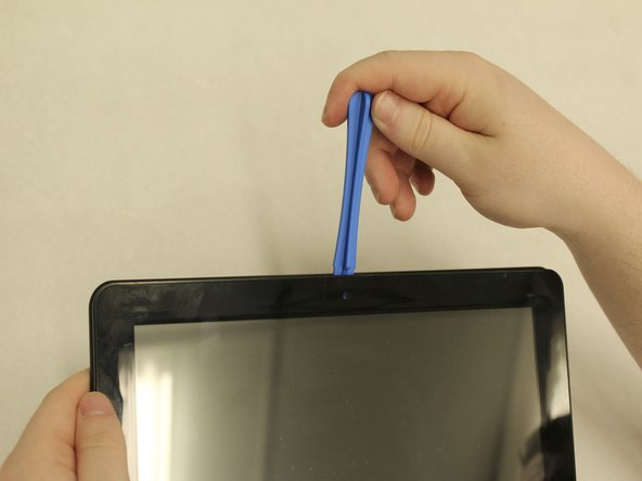 To begin, insert the plastic opening tool between the display and back cover and apply force until the back cover comes free from the device.