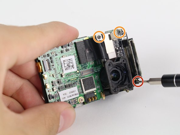 The media adapter is attached to the motherboard via 3 screws: