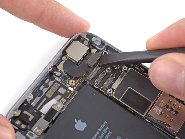 Use the flat end of a spudger to lift the rear-facing camera connector up off of its socket on the logic board.
