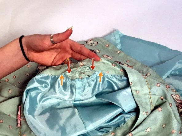 Red arrows indicate the length of the measurement. Orange arrows indicate the length of seam ripped.