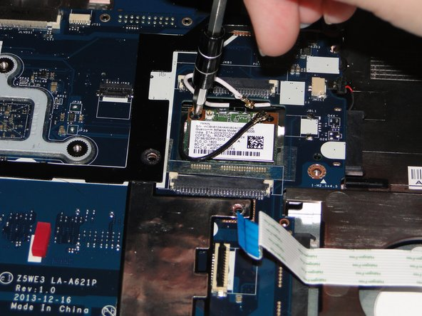 Using a Phillips 1 screwdriver, remove the black 5mm screw from the fan.