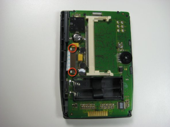 Image 1/2: Locate the white ribbon wire on the left hand side of the device.