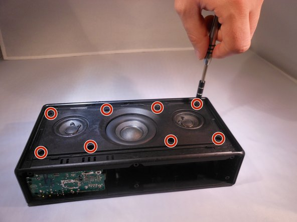 Remove the eight 0.5mm Phillips #1 screws from the speaker panel.