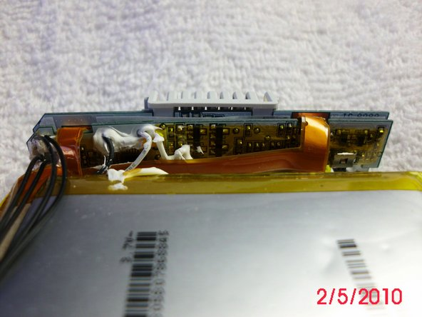 Image 3/3: The white paste looking stuff is where the battery pack broke open and leaked.