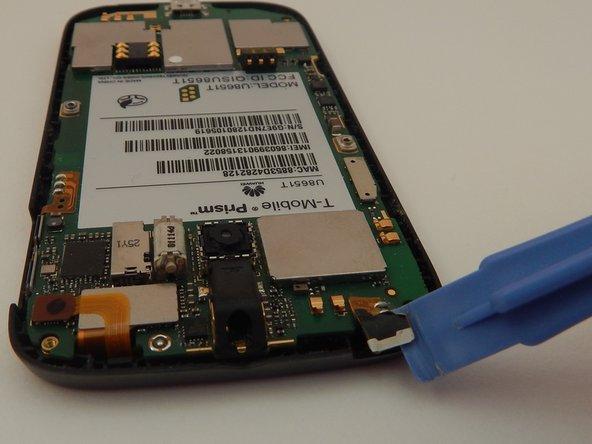 Image 3/3: Pry the sensor strip up.