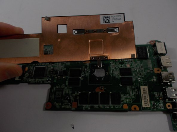 Lift the copper colored heat sink away from the motherboard.