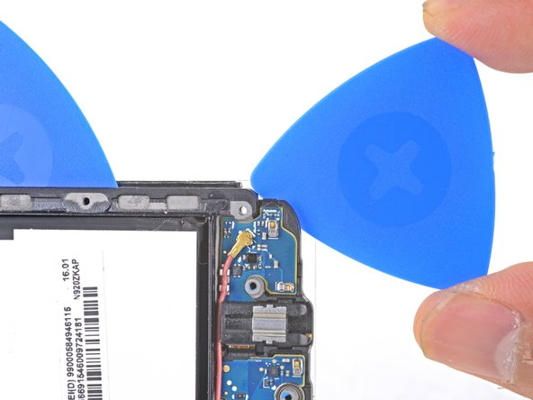 Slide an opening pick from the battery edge battery edge of the phone along the edge of the phone to safely cut over the capacitive button.