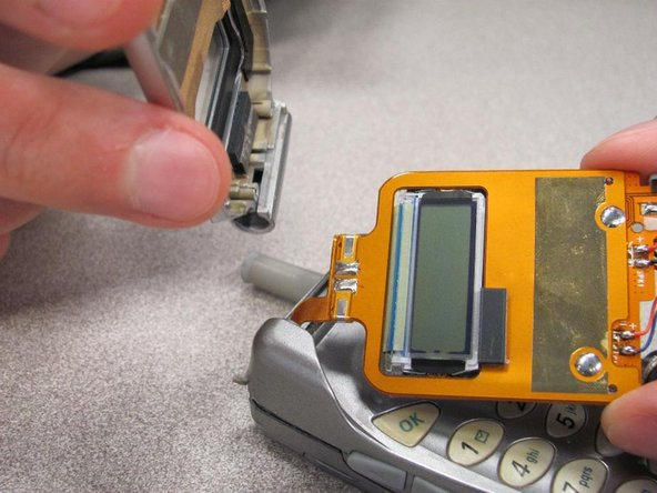 Remove remaining portion of the front case from the flexible circuit board.