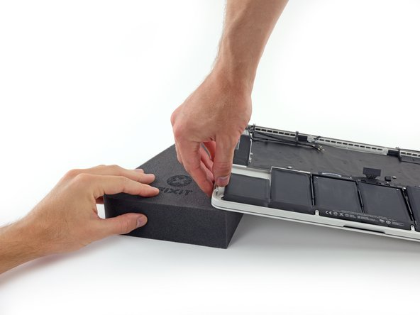 It's time to switch sides. Remove your book or foam block and place it under the opposite side of your MacBook Pro.