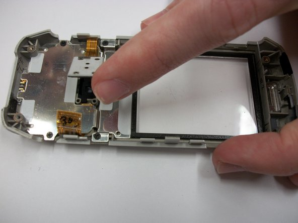 Loosen the keypad connector by lifting the rectangular plate up with one finger.