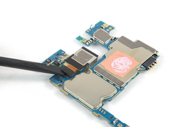 Flip the motherboard assembly and use the flat end of a spudger to carefully disconnect the flex cable of the rear camera.