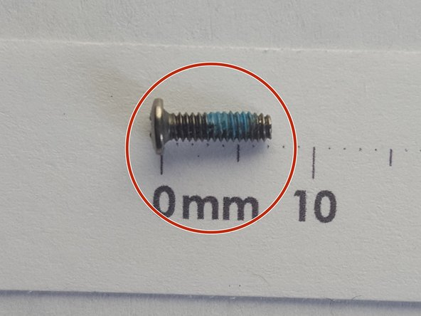 Using PH 01 remove two 7mm  PH screws.