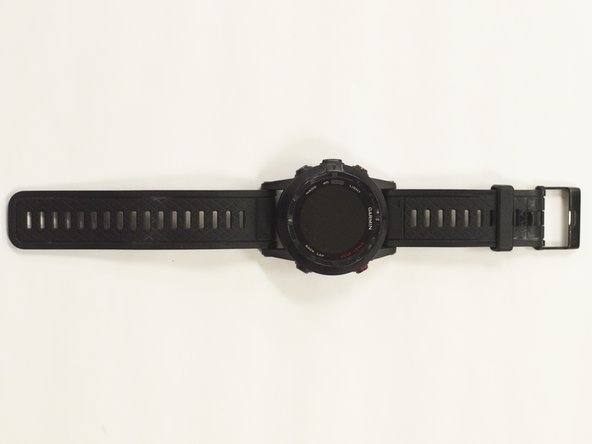 Grab your Garmin watch and flip it over to get a good view of the four screws that connect the straps to the housing.